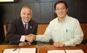USC Viterbi Dean Yannis Yortsos and TCCHK Group Chairman and CEO Kenneth Koo sign a memorandum establishing the new USC institute.